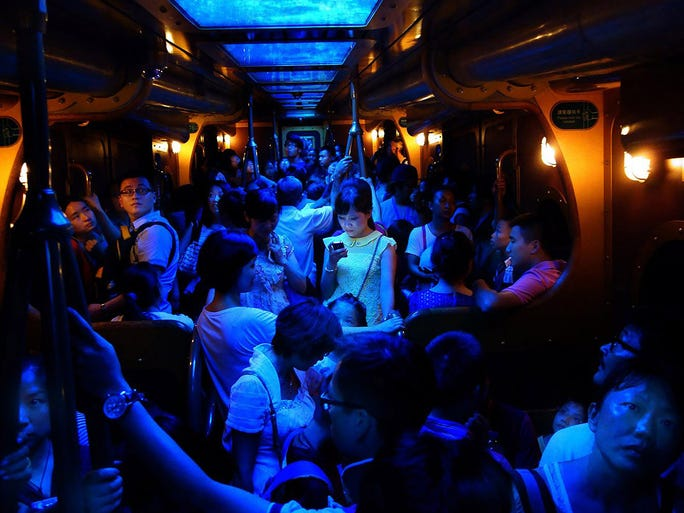 A woman stands in the center of a packed train as she travels between two amusement park rides at Ocean Park in Hong Kong. The following images are entries in the 2013 National Geographic photo contest, which ends on Nov. 30. Enter your photograph at www.ngphotocontest.com