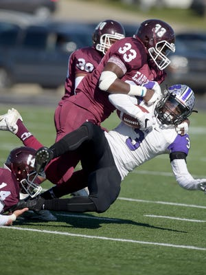 Earlham and Bluffton compete Saturday, Nov. 5, during a football game at Earlham College in Richmond.