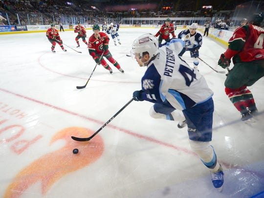 Milwaukee Admirals center Emil Pettersson looks to make a pass on Friday.