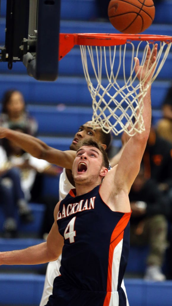 Blackman's Christian DeWitt shoots against Siegel in the second half Tuesday, Jan. 20, 2015 at Siegel.