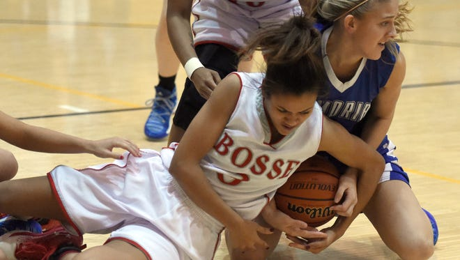 Kiara Bailey of Bosse and Grace Lensing of Memorial scramble for a loose ball during the first quarter of the game at Gibson Southern in Fort Branch Tuesday.