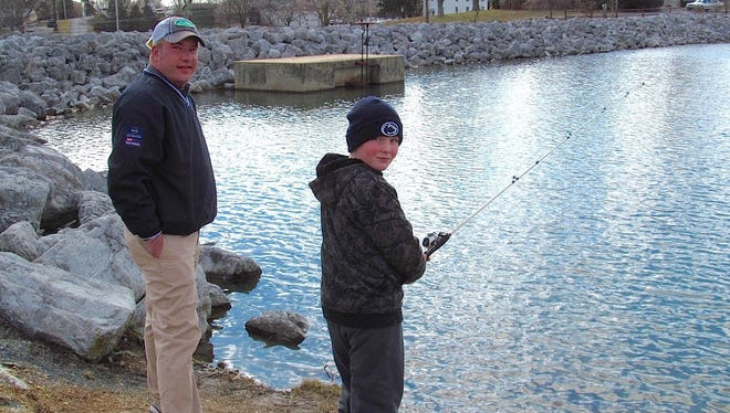 Timothy Kiphorn and his fishing buddy, Andrew, enjoyed the state's first-ever Mentored Youth Trout Day at Lions Lake in 2013. This year, adults can fish too, but only kids may keep trout.