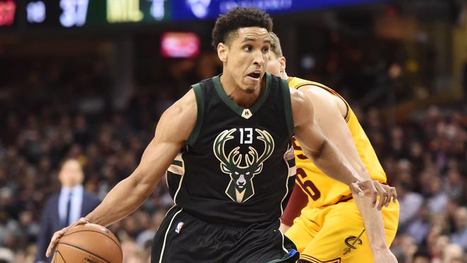 Bucks guard Malcolm Brogdon drives to the basket against the Cleveland Cavaliers.