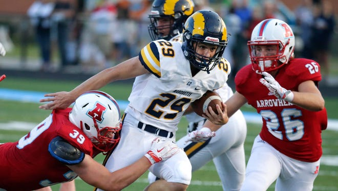 Marquette's running back Daniel Carter (shown against Arrowhead) helped defeat Germantown on Friday.