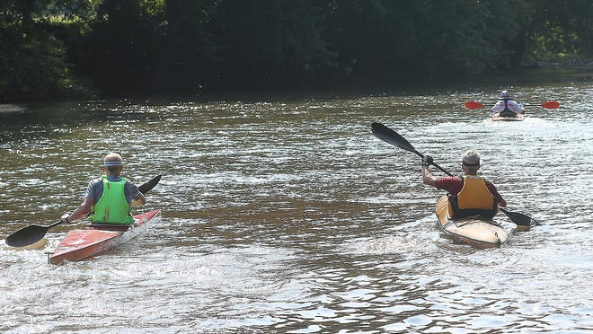 Kayakers start down the Tuscarawas River from Zoar.