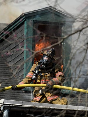 A three-alarm fire heavily damaged two homes in the 400 block of Cumberland St. in Lebanon on Wednesday, April 6, 2016