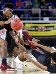East Hamilton's Christian Pasley (3) tries to pass the ball after getting a run away ball while Memphis East's Antavion Collum (5) and Derrein Merriweather (13) try to get the same ball during the quarterfinal round of the Class AAA State Tournament on Wednesday, March 15, 2017.