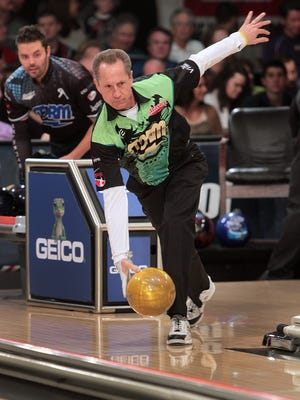 Pete Weber, right, bowls, as his opponent Jason Belmonte watches during the title match of the Barbasol PBA Tournament of Champions, at Woodland Bowl, Sunday, March 31, 2013.  Weber won the championship match.  Kelly Wilkinson / The Star