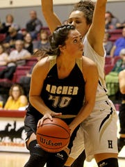 Archer City's Kacey Hasley looks to the basket in the