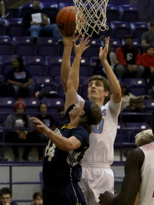 Hirschi's Pietro Lazzarotto shoots over Stephenville's Mason Holstein Saturday, Feb. 24, 2018, in the Region I-4A area round playoff game in Jacksboro. The Huskies defeated the Yellow Jackets 85-48.