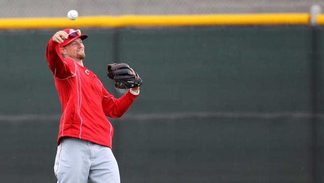 Reds starting pitcher Mike Leake throws in the outfield Sunday at spring training in Goodyear, Ariz.