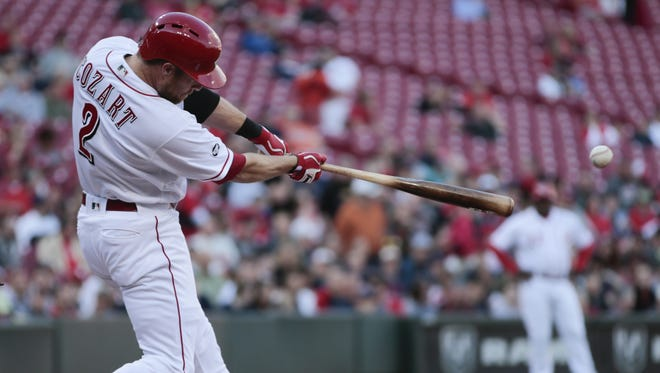 Cincinnati Reds shortstop Zack Cozart (2) hits a single in the first inning during the MLB game between the Cleveland Indians and the Cincinnati Reds, Wednesday, May 18, 2016, at Great American Ball Park.