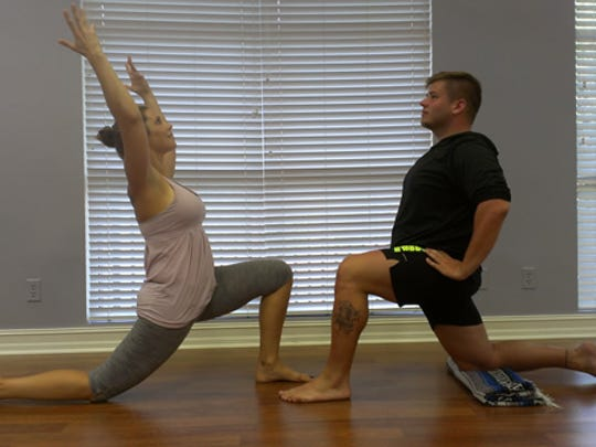 Emily Chiodo and David Simmons of Joyful Yoga demonstrate low lunge to open the psoas muscles.