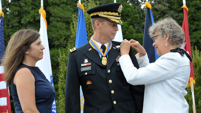 Oregon Military Department Maj. Gen. Daniel R. Hokanson stands between his wife, Kelly, and mother, Dianne Hokanson, as they pin on his new rank as lieutenant general during his promotion ceremony on Aug. 15, 2015.