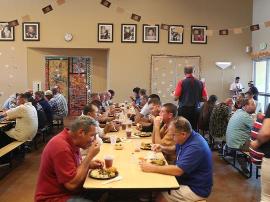 Guests enjoy a Thanksgiving meal at the Coachella Valley Rescue Mission in Indio, November 23, 2017.