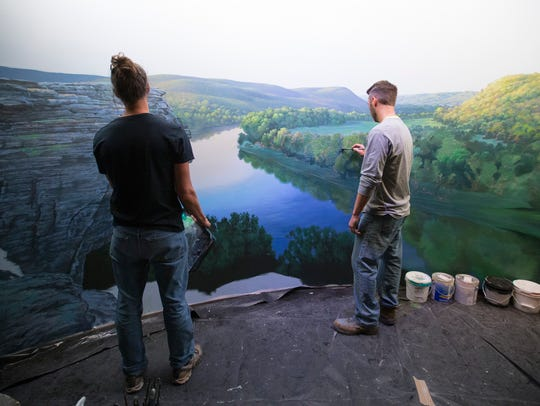 Brothers Aaron (left) and Adam Wolken paint a mural