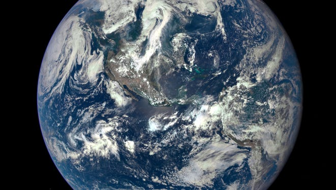 This NASA handout image released July 20, 2015, shows Earth as seen on July 6, 2015, from a distance of one million miles captured by a NASA scientific camera aboard the Deep Space Climate Observatory spacecraft.