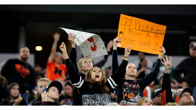 Refugio fans cheer during the fourth quarter of the Bobcats' 23-20 win the Class 2A Div. I state championship game on Thursday, Dec. 15, 2016, at AT&T Stadium in Arlington.