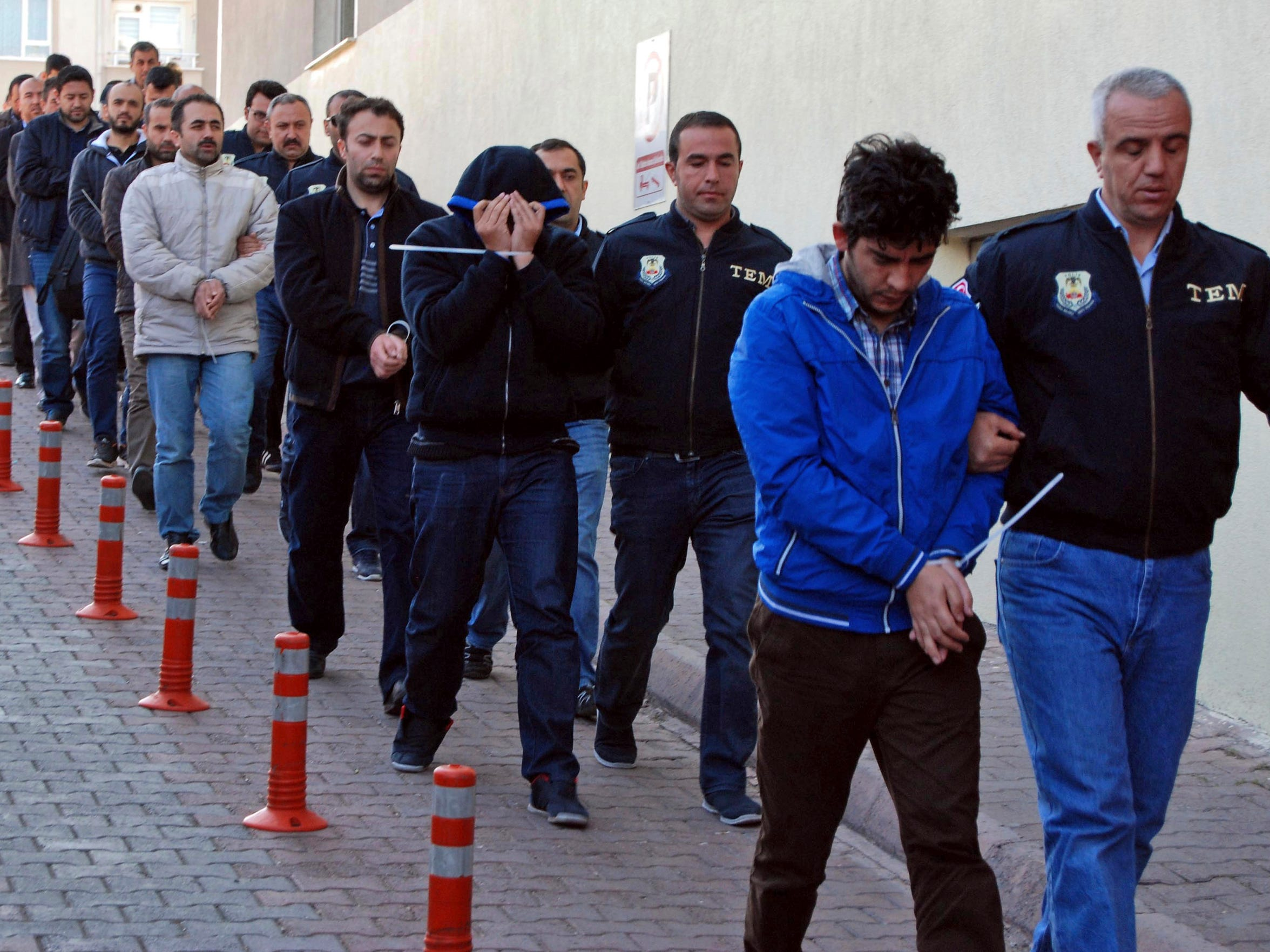 Police officers escort people, arrested because of suspected links to U.S.-based cleric Fethullah Gulen, in Kayseri, Turkey,  April 26. Police launched simultaneous operations across the country on Wednesday, detaining hundreds of people with suspected links to U.S.-based cleric Fethullah Gulen. The suspects are allegedly Gulen operatives who directed followers within the police force.