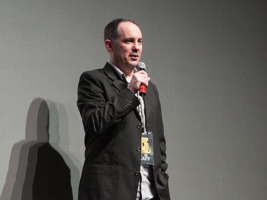 Freep Film Festival executive director Steve Byrne addresses the crowd before the start of the evening's screening during the opening night of the Freep Film Festival on Thursday, March 19, 2015 at the Fillmore in Detroit.