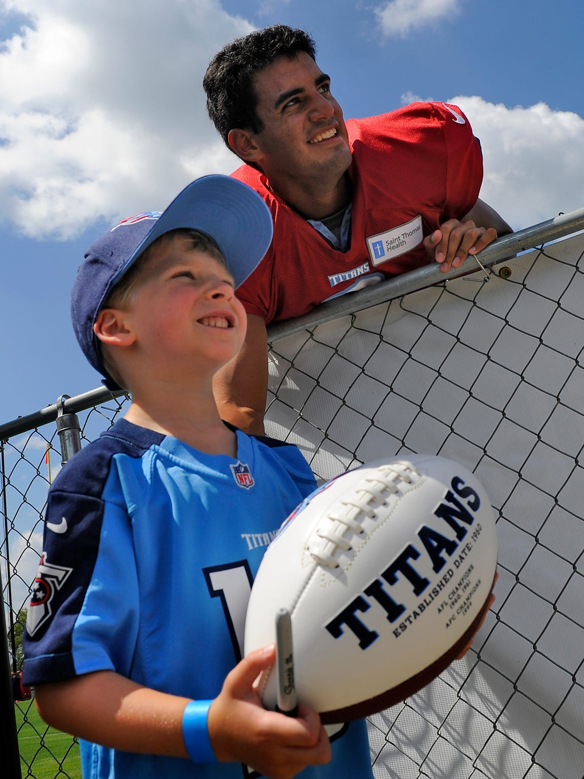 Cayden Lewis 5, of Hendersonville, gets a photo with Mariota after practice at St. Thomas Sports Park on Aug. 11.