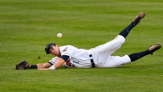 St. Cloud Rox center fielder Mason Mamarella dives for a fly ball but comes up short, leaving Eau Claire batter Daulton Varsho safe at second base in the first inning Tuesday at Joe Faber Field.