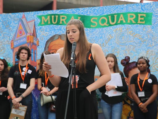 Arlington student Angela McDevitt, 17, delivers a speech on Sunday. She discussed the need for stricter gun laws as well as increased mental health help in the wake of school shootings.