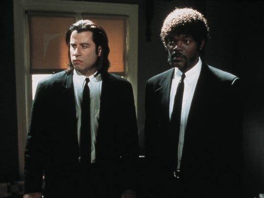 John Travolta (left) and Samuel L. Jackson as hit men