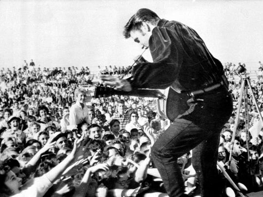 "Elvis Presley performs in Tupelo, Mississippi, in September 1956. That year, Presley had a No. 1 hit with ""Heartbreak Hotel."""