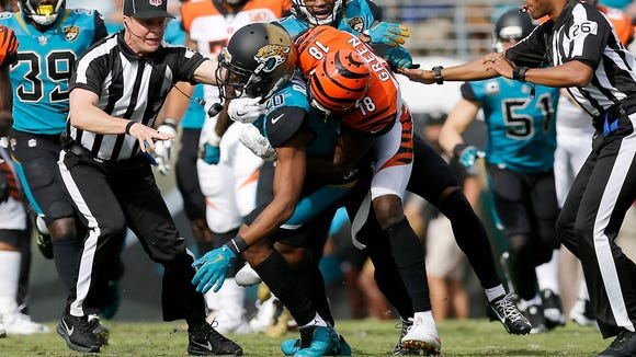 Cincinnati Bengals wide receiver A.J. Green (18) pulls Jacksonville Jaguars cornerback Jalen Ramsey (20) after throwing a punch after a play late in the second quarter of the NFL Week 9 game between the Jacksonville Jaguars and the Cincinnati Bengals at EverBank Field in Jacksonville, Fla., on Sunday, Nov. 5, 2017. At halftime the Bengals trailed 10-7 after wide receiver A.J. Green was ejected for throwing a punch.