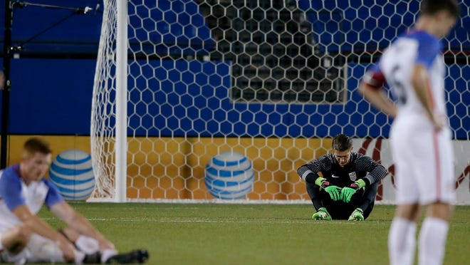 U.S. goalie Ethan Horvath, center, and forward Will Trapp react after the team's 2-1 loss to Colombia in an Olympic qualifying soccer match in Frisco, Texas.