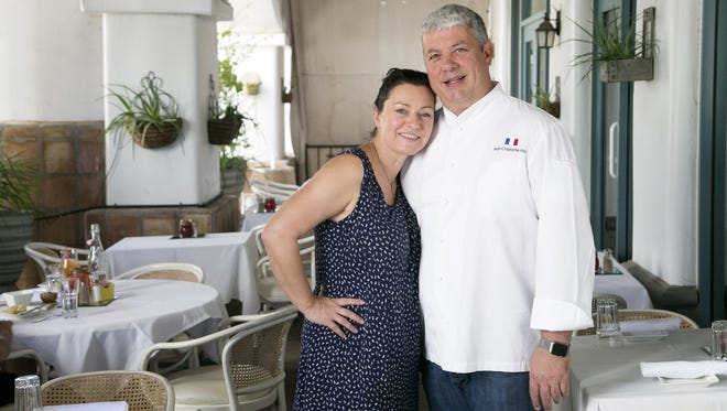Voila French Bistro co-owners and husband and wife, Ségolène Grow (left) and Jean-Christopher Gros at their French bistro in Scottsdale on Oct. 24, 2017. Jean-Christopher Gros is also the chef of the restaurant.