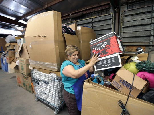 Salvation Army Thrift Shop Store Manager Yvonne Serna sorts donated items at the northeast El Paso store Tuesday. The Salvation Army is getting ready for their Stuff the Truck event this Saturday and Sunday from 9am-4pm. For every 20 pounds donated, donors will receive a raffle ticket and a chance to win prizes.
