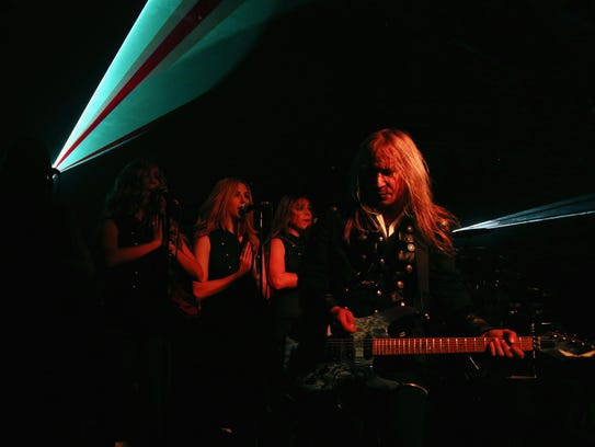 Chris Caffery (R) and members of Trans-Siberian Orchestra
