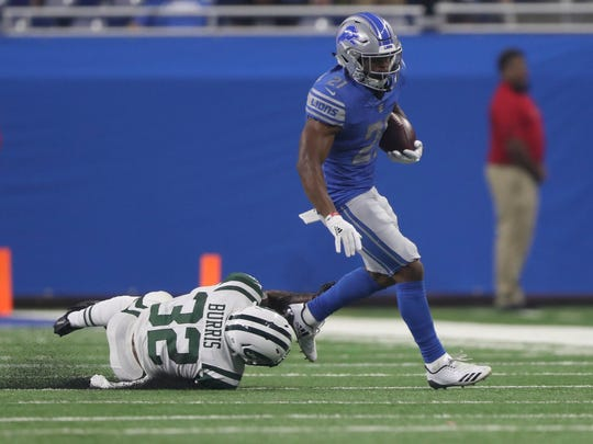Running back Ameer Abdullah eludes the Jets' Juston Burris during the first quarter of the Lions' 16-6 exhibition win Saturday, Aug. 19, 2017, at Ford Field.