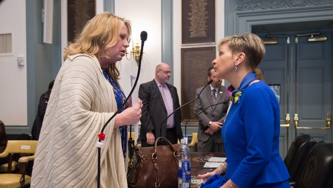 Helene M. Keeley, D-Wilmington South, left, and Cathy Rossi, vice president of Public and Government Affairs for AAA Mid Atlantic, talk before the start of the Adult Use Cannabis Task Force meeting at Legislative Hall in Dover.