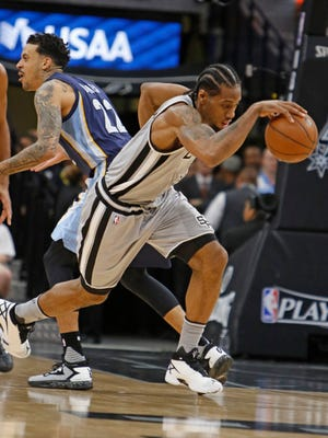 Kawhi Leonard #2 of the San Antonio Spurs takes off after stealing the ball from Matt Barnes #22 of the Memphis Grizzlies in Game 1 of the Western Conference Quarterfinals.