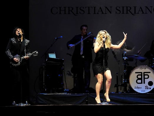 The Band Perry performs at the Symphony Fashion Show at Schermerhorn Symphony Center in Nashville, Tenn., Tuesday, April 29, 2014.