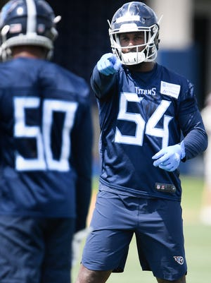 Titans linebacker Rashaan Evans (54) points to a player during rookie minicamp Saturday at Saint Thomas Sports Park.