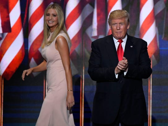 Ivanka Trump, wearing a dress from her brand, leaves