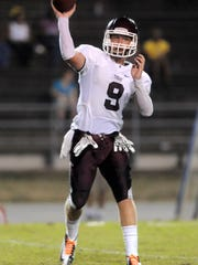 Pensacola High School's Blake Norwood makes a pass