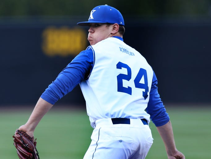 St. Xavier starting pitcher Alex Kenner (24) throws a pitch against Moeller in the first inning.