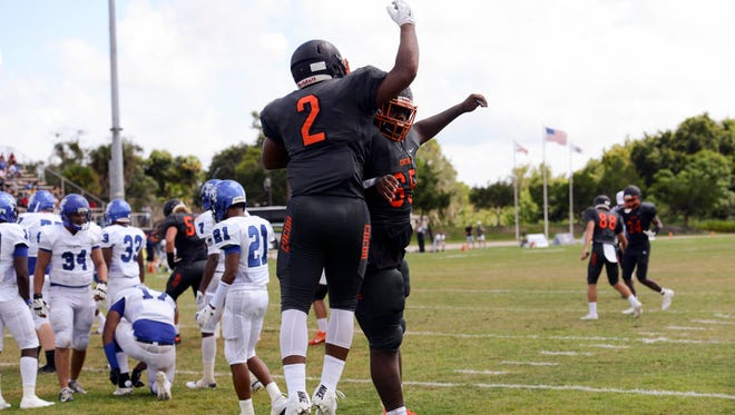 Timmy Pratt of Cocoa celebrates a first quarter TD with teammate Naceiya Gilmore during Sunday's game.