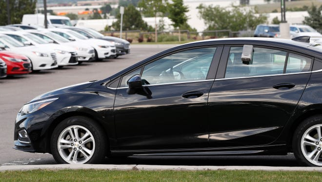 A used 2017 Chevrolet Cruze sits in a row of other used, late-model sedans at a dealership in Centennial, Colo. Prices of used small cars are on the rise after falling for the past five years.