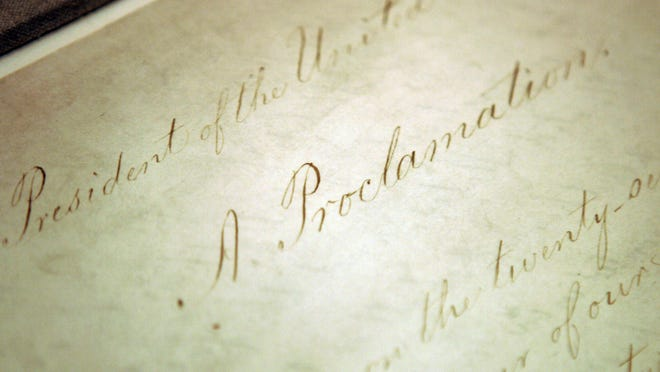 This photo shows the original Emancipation Proclamation on display in the Rotunda of the National Archives in Washington. President Abraham Lincoln first issued the Emancipation Proclamation declaring all slaves free in Confederate territory on Sept. 22, 1862.