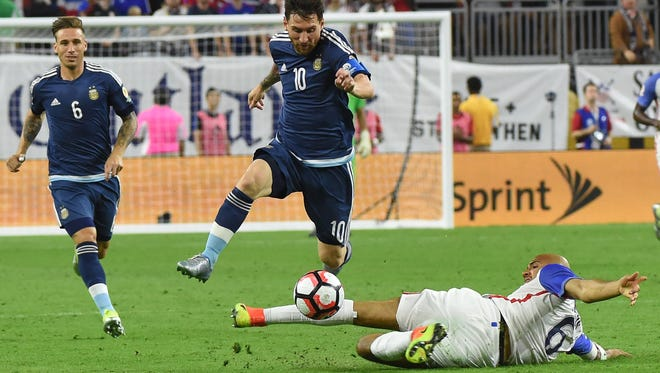 Argentina's Lionel Messi takes the ball past USA's John Brooks during the Copa America semifinal match on Tuesday.