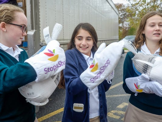 Students unload turkey donation