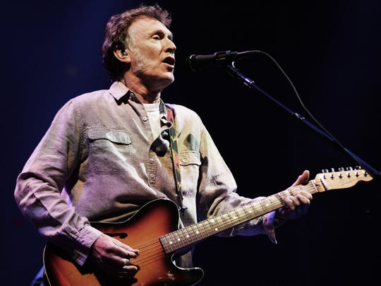 Steve Winwood sings live in concert.