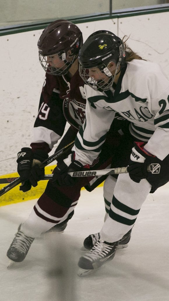 Morristown-Beard senior Keegan Heher and Kent Place's Megan Sanford scrap for the puck. Wednesday, Dec. 6, 2017.   MOR 1206 Beard girls hockey