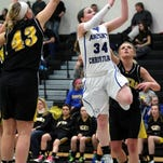 Senior point guard Madison Laib scored 17 points for Ankeny Christian Academy Friday night in the Lady Eagles' loss to Martensdale-St. Marys in Class 1-A semifinal regional play. Laib led the Bluegrass Conference in points scored this season. She scored 31 points in a quarterfinal win, pictured here, over Guthrie Center.